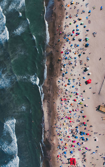 High angle view of multi colored umbrellas on rock