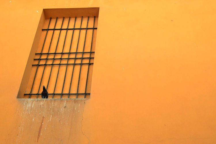 View of yellow wall against orange sky