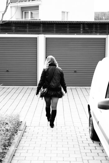 rear view of woman walking on footpath Walking Architecture Full Length One Person Real People Transportation City Lifestyles Rear View Women Built Structure Street Building Exterior Footpath Day Mode Of Transportation Adult Motor Vehicle Land Vehicle Outdoors Warm Clothing Hairstyle