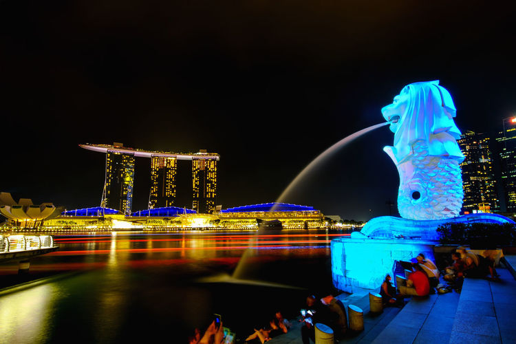 merlion singapore Marina Bay Sands Marina Bay Sands Hotel Marina Bay Singapore Singapore Singapore View Amusement Park Architecture Bay Building Building Exterior Built Structure City Group Of People Illuminated Merlion Singapore Motion Nature Night Office Building Exterior Outdoors Real People Reflection Sea Singapore City Sky Tourism Travel Travel Destinations Water