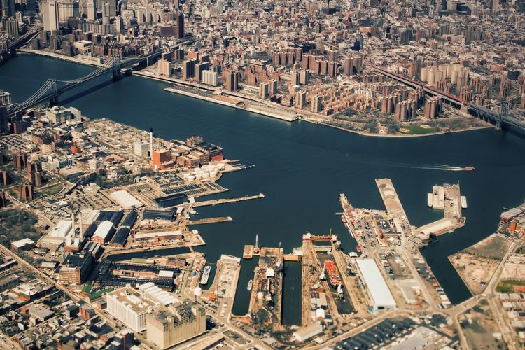 Aerial view of east river amidst cityscape