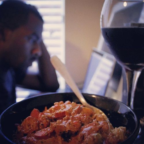 Working the 2nd shift from home while enjoying a late lunch compliments of the mother of my lady: Vodka & roasted red pepper chicken & sausage over angel hair pasta. Man, that was good... Hardatwork GreatEats DailyHustle Instagood