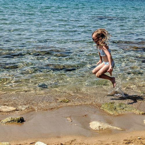 Full length of woman at beach