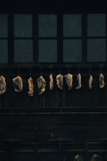 Low angle view of clothes hanging on window in building