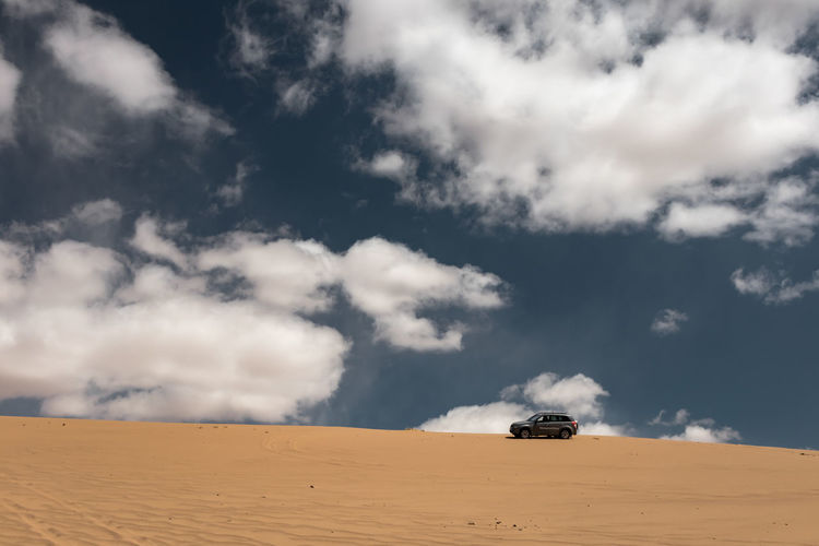 Mongolia Sky Cloud - Sky Mode Of Transportation Scenics - Nature Land Land Vehicle Sand Transportation Off-road Vehicle Beauty In Nature Nature Motor Vehicle No People Landscape Car Day Desert Travel Environment Non-urban Scene Arid Climate Climate Outdoors Sports Utility Vehicle Road Trip