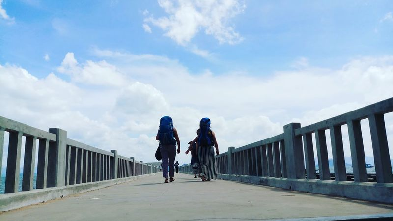 EyeEmNewHere EyeEm Selects RASTA Reggae love yourself Man food stories เดินทาง Backpack Colour Your Horizn Bridge - Man Made Structure Railing Outdoors Sky Day Cloud - Sky Togetherness Sunlight Friendship People