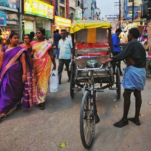 Indian Culture  India Colorful Street Streetphotography People Peoples Festival Temple Crowd Gathering Womens Madurai EyeEm Masterclass EyeEm Gallery EyeEm Selects EyeEmNewHere Fineart City Life Color Portrait Colours Of Life City Men Women Street Full Length Rickshaw Tricycle Taxi Bicycle Focus On The Story Small Business Heroes