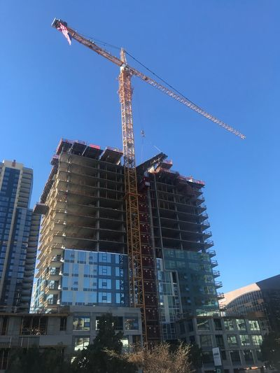 Construction Site Architecture Development Construction Crane - Construction Machinery Crane Built Structure Building Exterior Progress Low Angle View Building - Activity Blue No People Construction Machinery Clear Sky Industry City Outdoors Day Growth Comfort Systems USA
