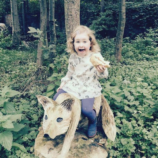 Childhood Looking At Camera One Person Portrait Tree Blond Hair Real People Outdoors Lifestyles Day Animal Themes Nature People Lovely Day Beautiful Nature Neice Carved Wood Carving Carved In Wood Carved Animal Carved Fox Child Break The Mold