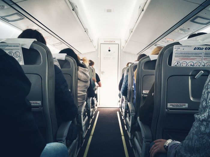 People sitting in airplane
