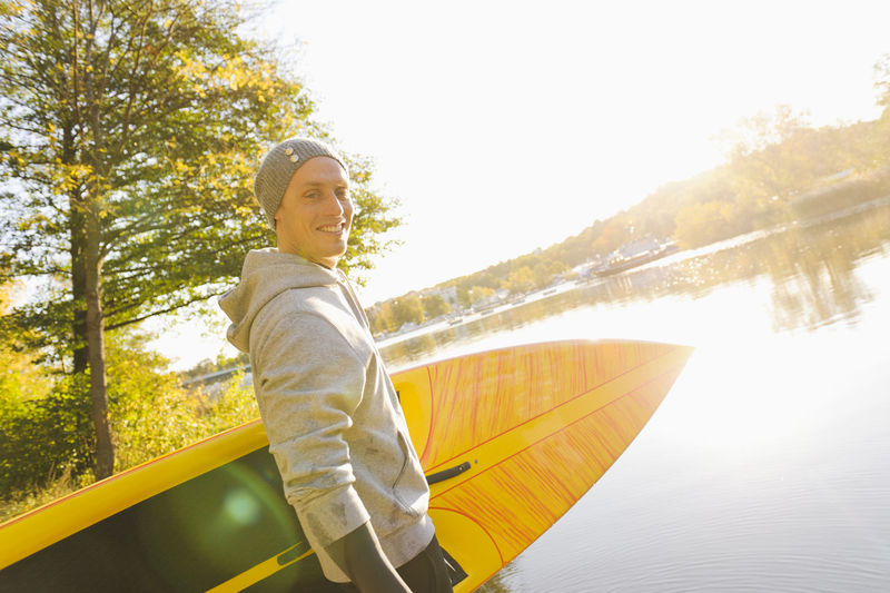 Portrait of smiling woman on boat in lake