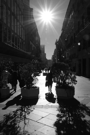 Callao Madrid Preciados Blackandwhite Street Photography Hanging Out Travel Destinations EyeEm Best Shots Taking Photos Enjoying Life Streetphotography Check This Out Building Exterior Architecture Real People City Sun Shadow Outdoors Men Large Group Of People Tree Day Sky The City Light Welcome To Black The Street Photographer The Street Photographer - 2017 EyeEm Awards