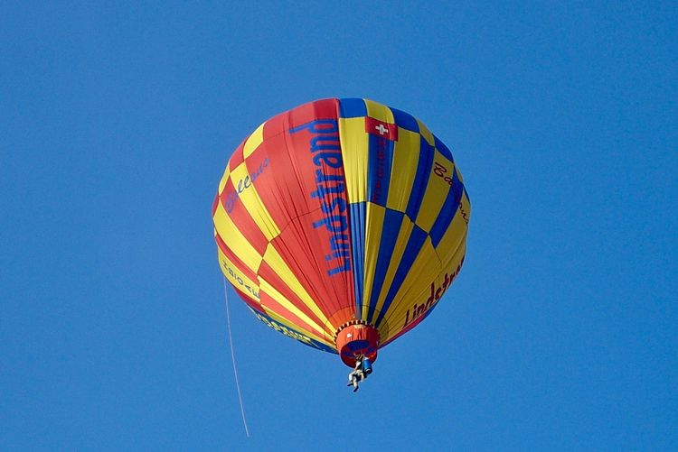 Going up Adventure Air Vehicle Balloon Blue Clear Sky Copy Space Day Extreme Sports Flying Freedom Hot Air Balloon Leisure Activity Low Angle View Mid-air Multi Colored Nature Outdoors Parachute Paragliding Parasailing Sky Sport Transportation