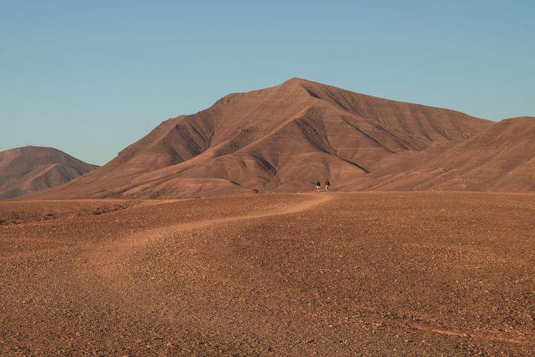 Desert path red soil blue sky