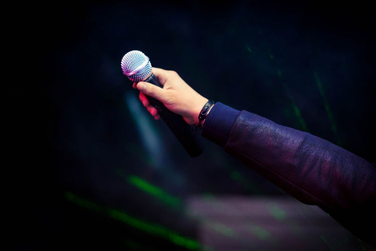 Adult Adults Only Arts Culture And Entertainment Close-up Concert Concert Photography Detail Hand Human Body Part Human Hand Micro Microphone Music Music Musician One Person One Woman Only People Performance Singer  Singer  TakeoverMusic