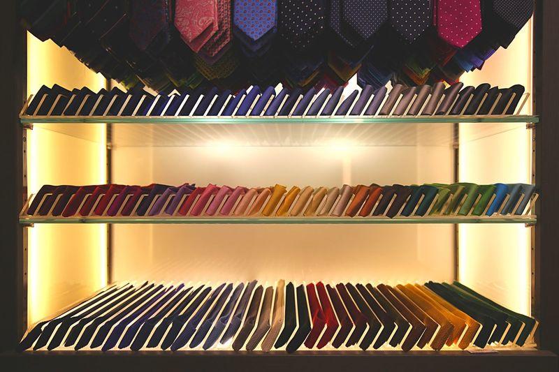 Beautifully Organized Multi Colored Shelf Indoors  Shelves No People Arrangement Variation Bookshelf Day Carefully Arranged Indoors  Ties Silk
