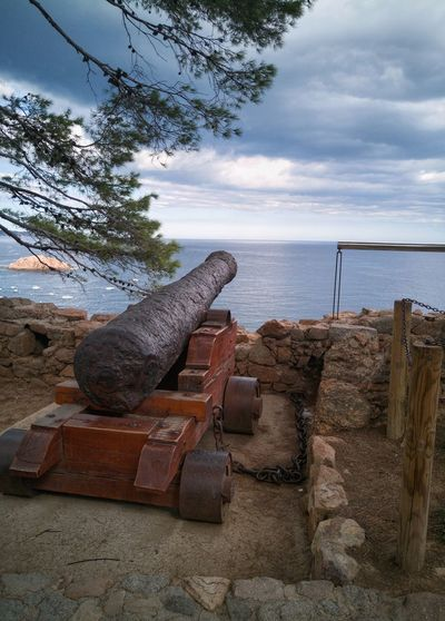 History & Holidays 💖 History No People Ancient Outdoors Day Tree Sky Mediterranean Sea EyeEmNewHere Huawei P10 Plus Historical Site Military Cannon Cannon Tossa De Mar Catalunya Catalunyaexperience Catalunya Costa Brava History Lover Coastline Landscape Cliff View Military Mediterranean Landscape Mediterranean Coast Travel Destinations Vacations The Week On EyeEm