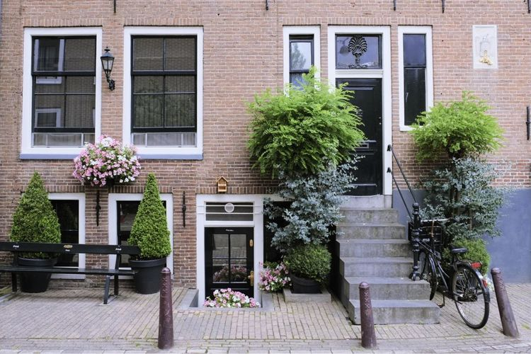 Window Architecture Building Exterior Built Structure Brick Wall House Door Amsterdam 020 Flower Residential Building Day Façade Plant No People Bicycle Window Box Beauty City Apartment