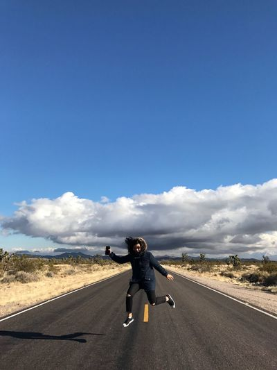 Freedom Jump Byiphone7plus IPhoneography Iphone7plusphoto Road Sky Cloud - Sky Full Length Transportation Day One Person Leisure Activity Outdoors Casual Clothing Real People Blue Lifestyles One Man Only Standing Nature