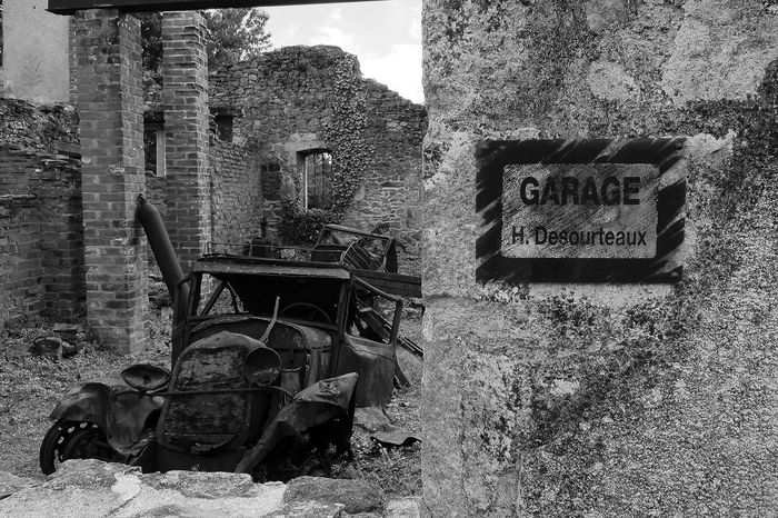 Garage remains with car Oradour sur-Glene Abandoned Built Structure Garage No People Old Car Outdoors Rusting Stone Walls Vehicle Remains