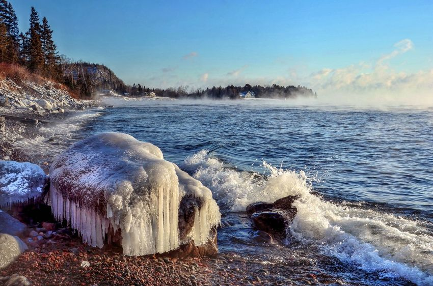 Sea Smoke and icicles on the North Shore of Superior Water Nature Motion Splashing Beauty In Nature Outdoors Sky Sea Day Scenics No People Animal Themes Mammal Waterfall Malephotographerofthemonth Lake Superior Minnesota EyeEm Best Shots Bestoftheday Beauty In Nature EyeEm Nature Lover EyeEm