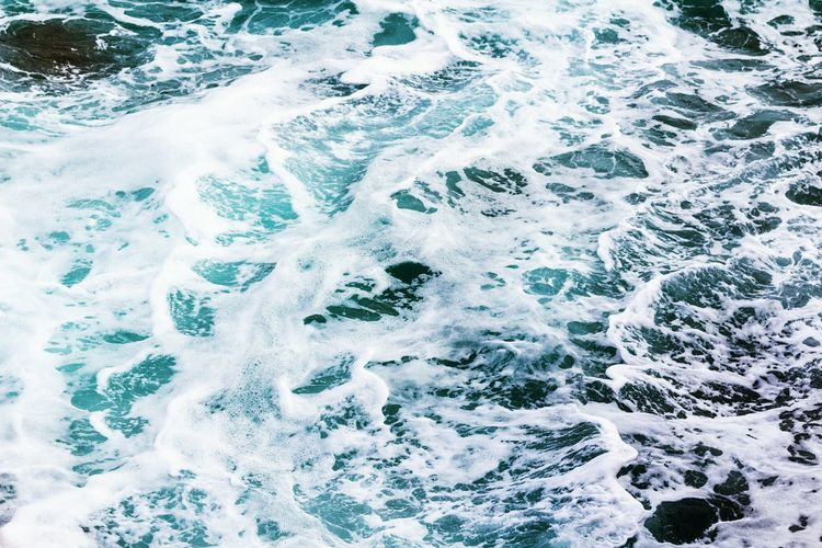 High angle view of waves splashing water in sea