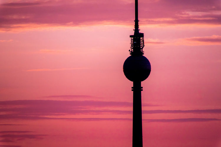 Silhouette Communications Tower Against Sky During Sunset