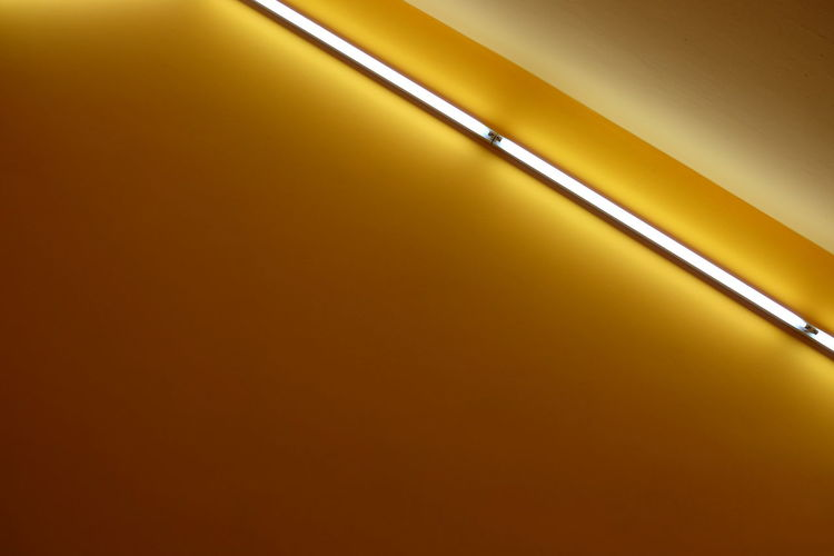 Low Angle View Of Tube Light On The Wall