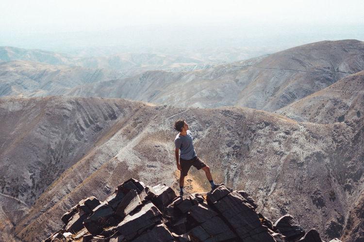Full length of man looking at mountain range