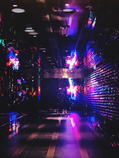 Illuminated lights on road in city at night