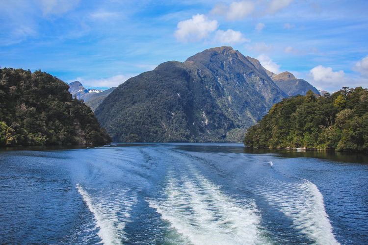 Doubtful Sound cruise - passing beautiful scenery in Fiordland National Park, South Island, New Zealand New Zealand New Zealand Scenery Scenery Nature Landscape Doubtful Doubtful Sound Sound South Island Manapouri Te Anau Cruise Day Trip Outdoors Outside Idyllic Water No People Non-urban Scene Fiord Fiordland Fiordland National Park National Park Southland Cliff Rocks Sea Ocean Scenics - Nature Mountain Beauty In Nature Sky Waterfront Cloud - Sky Day Tranquil Scene Tranquility Mountain Range Wake - Water Tree Plant Flowing Water Mountain Peak