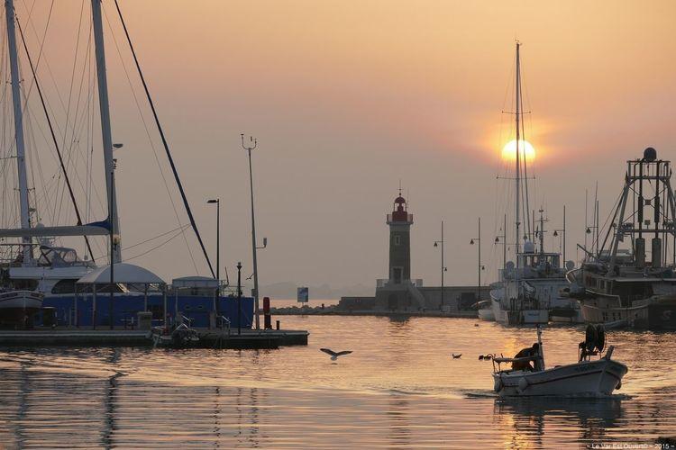 Harbor against sunset sky at saint-tropez