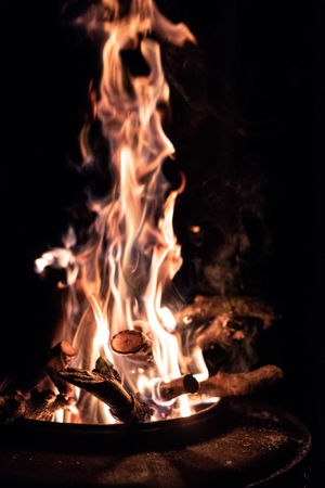 Flame Burning Fire Fire - Natural Phenomenon Heat - Temperature Glowing No People Night Nature Close-up Dark Wood - Material Log Orange Color Wood Bonfire Firewood Motion Long Exposure Focus On Foreground Campfire Black Background