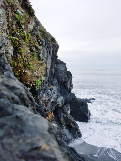 Sea Rock - Object Beach Cliff Outdoors Beauty In Nature Wave Mountain Beach Rock Rock Flowers High Angle View