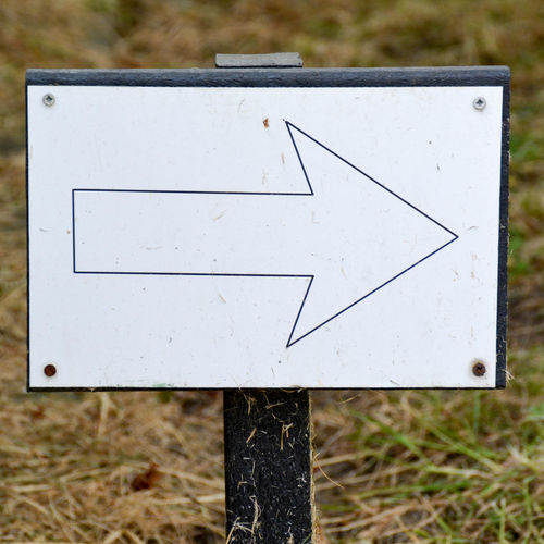 Arrow Board By Hand Close-up Communication Day Drawn Focus On Foreground Grass Hay Indication Man Made Object Map Nature Outdoors Pointing Post Right Sign Signal Somewhere Symbol Turn Turn Left Turn Right
