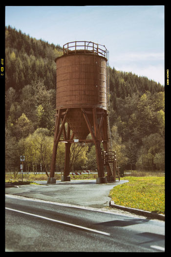 Frankenwald Road Tree Auto Post Production Filter Transportation Water Tower - Storage Tank No People Architecture Nature Built Structure Transfer Print Day Sky Plant Storage Tank Outdoors Water Conservation Road Marking Sign Marking Environment