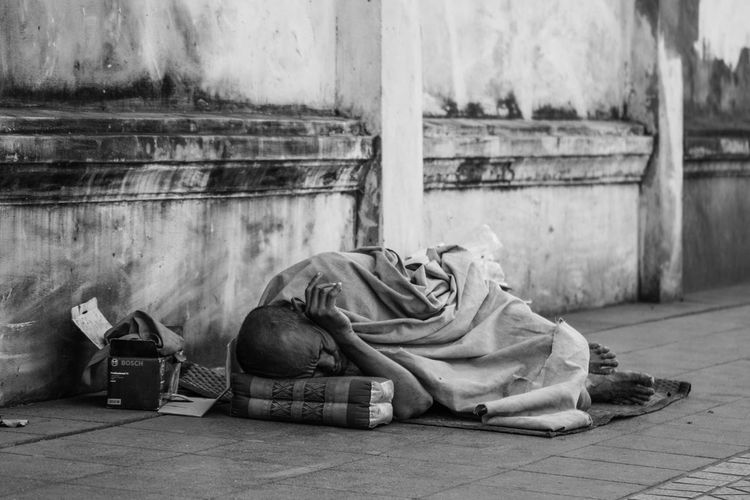 Homeless and cold on a Bangkok street. Hungry Poor  Beggar Blackandwhite Day Desperate Destitute High Contrast Homeless Lying Down No Hope Outdoors Uncomfortable