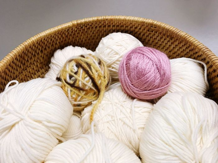 It's knitting time! Studio Shot Ball Of Wool Balls! Indoors  Close Up Yarns Yarnball Knit Knitting Knitting Wool Basket Wicker Basket Hobby Pasttime Activity White Pink Brown Hobby Hobbytime Let's Get Dangerous Let's Do This Arts And Crafts Creativity Crafting Time