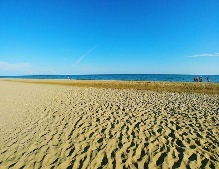 EyeEm Selects Water Sea Clear Sky Sand Dune Beach Blue Sand Sunny Sky Horizon Over Water