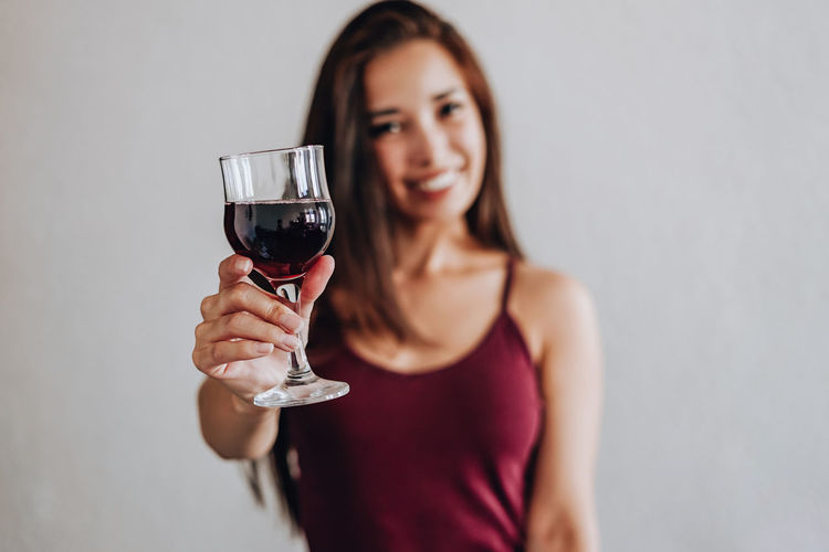 Portrait of a woman drinking glass
