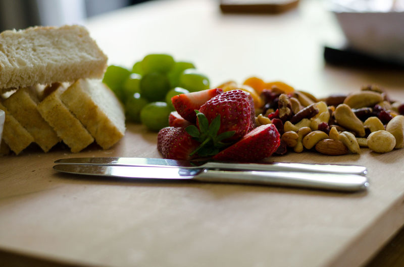 Close-up of fresh strawberries in plate on table