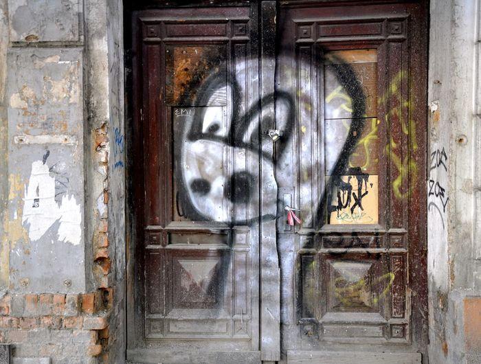 Graffiti on closed building door