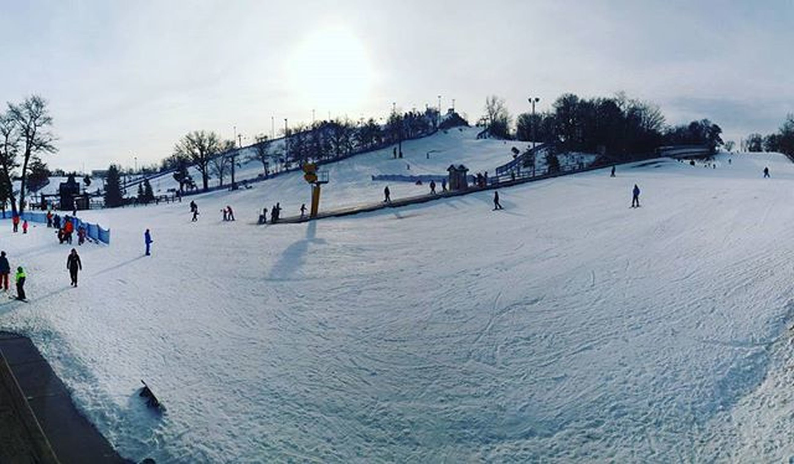 snow, winter, cold temperature, season, weather, sky, covering, large group of people, white color, sunlight, incidental people, nature, frozen, landscape, day, tree, snow covered, tranquility, outdoors
