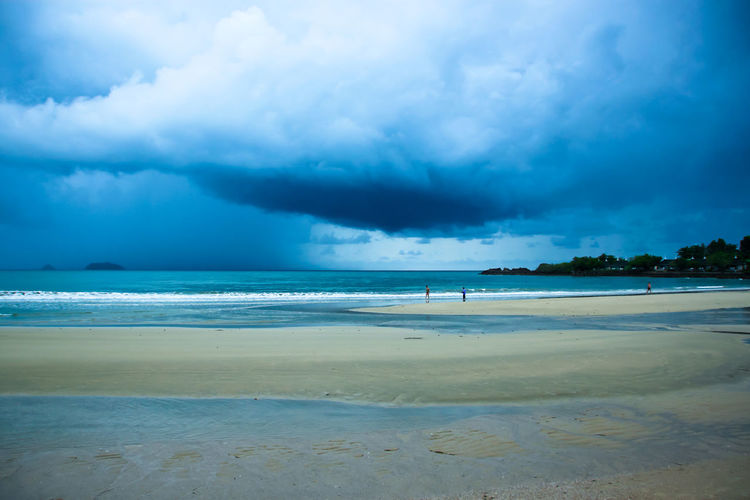 Strom in coming at the beach. Sea Beach Blue Sand Seascape Sky Landscape Dramatic Sky Nature Horizon Scenics Coastline Cloud - Sky Outdoors Wave Vacations Travel Environment Season  Rain Weather Strom Island Viewpoint Cloud