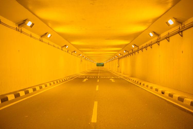 Illuminated lights in empty corridor