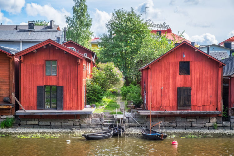 Beautiful city landscape with idyllic river and old buildings at summer day in Porvoo, Finland Built Structure Architecture Water Building Exterior Nautical Vessel Plant Building Nature Tree Day Waterfront House Cloud - Sky Transportation Mode Of Transportation No People Sky Outdoors Red Boathouse Canal Wooden Post City Old Vintage Boat Pier Landscape Summer Summertime Bright Porvoo Finland Red River Lush Foliage Town Village Wall Wood - Material