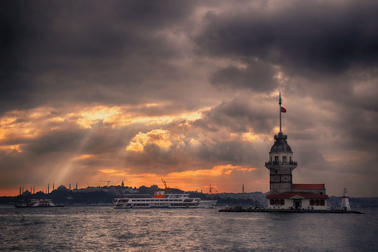 Scenic view of sea and buildings against sky during sunset. maiden's tower in turkey.