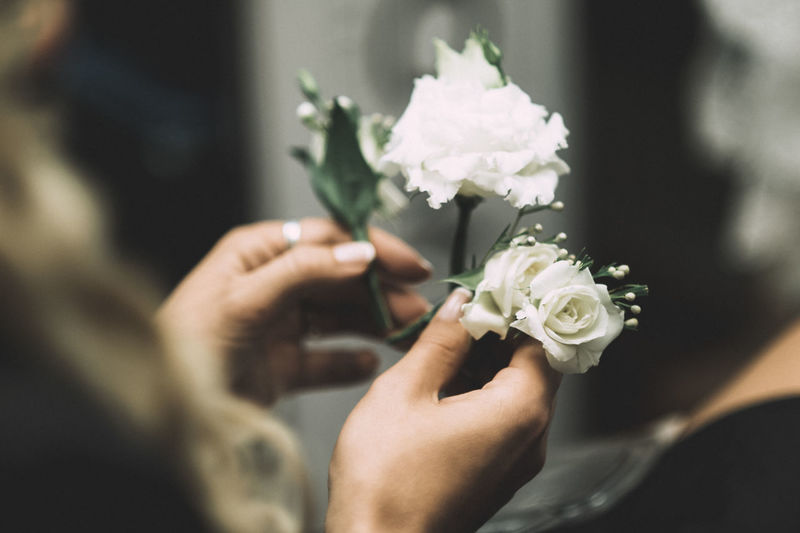 Cropped Hands Of Woman Holding Roses