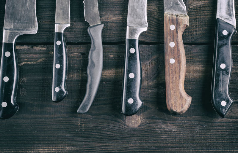 Directly above view of knives on wooden table