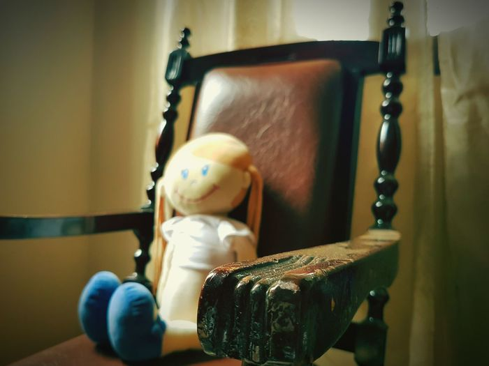 Indoors  Necklace Antique Wood - Material Old-fashioned No People Figurine  Close-up Doll Chair Armchair Shadows & Lights Retro Styled Antique Classic Style Premium Collection Getty Images EyeEmNewHere TCPM Vintage Old-fashioned Toys Break The Mold Children Kids EyeEm Selects